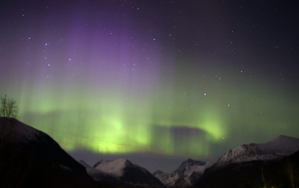 Beautiful Aurora Borealis over the valley.