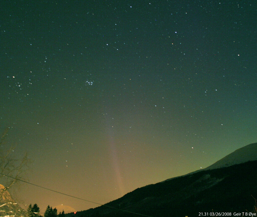 This STEVE like phenomenon was photographed through a layer of haze at 21.31 on March 26,2008.  Photographed with a spectrum enhanced camera. Canon EOS DIGITAL REBEL XTi. Sigma 17-70 mm lens @ 18 mm, ISO: 800, exposure time 39 seconds.